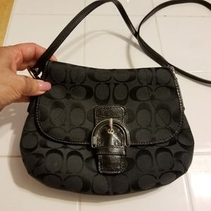 Barely used if at all. Small coach bag